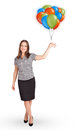 Young woman holding colorful balloons beautiful Stock Images