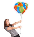 Young woman holding colorful balloons beautiful Royalty Free Stock Image