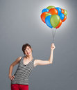 Young woman holding colorful balloons pretty Royalty Free Stock Photography