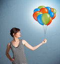 Young woman holding colorful balloons pretty Royalty Free Stock Images