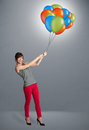 Young woman holding colorful balloons pretty Royalty Free Stock Photo