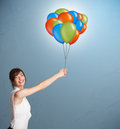 Young woman holding colorful balloons pretty Royalty Free Stock Photos