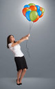 Young woman holding colorful balloons pretty Stock Photography