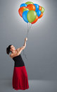 Young woman holding colorful balloons pretty Stock Photo