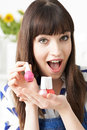 Young Woman Holding Colorful Bottles Of Nail Polish Royalty Free Stock Photo