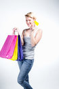 Young woman holding credit card and bags grey background Stock Photography