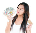 Young Woman Holding Credit Card And Money Stock Photo