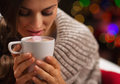 Young woman holding cup of hot chocolate Stock Photography