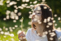 Young woman holding dandelion happy Stock Photos