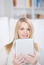 Young woman holding digital tablet closeup portrait of in house Stock Photo