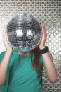 Young woman holding a disco ball in front of her face women Stock Image