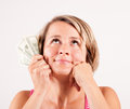 Young woman holding dollar bills in her hand and smiling Royalty Free Stock Photo