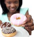 Young woman holding a donut Stock Photography
