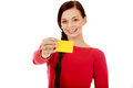 Young woman holding empty business card Royalty Free Stock Photography