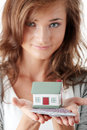Young woman holding euros bills and house model Stock Photography
