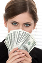 Young woman holding fan of hundred dollar bills portrait eyes close up shot Stock Photo