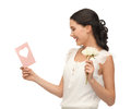 Young woman holding flower and postcard Royalty Free Stock Images