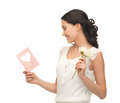 Young woman holding flower and postcard Royalty Free Stock Photo