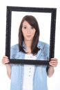 Young woman holding a frame Stock Photography
