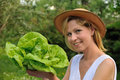 Young woman holding fresh lettuce Royalty Free Stock Photography