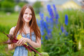 Young woman holding fresh organic vegetables Royalty Free Stock Photo