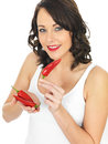 Young Woman Holding Fresh Red Chillies Royalty Free Stock Photo