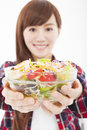 Young woman holding fruits and salad smiling Stock Photo