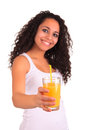 Young woman holding glass of orange juice  over white ba Royalty Free Stock Images