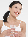 Young woman holding glass of water beautiful mixed race against white background Royalty Free Stock Photography