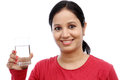 Young woman holding glass of water portrait against white Stock Image
