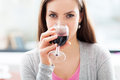Woman having glass of wine Royalty Free Stock Photo