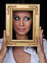 Young woman holding gold antique frame Stock Images