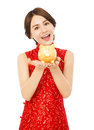 Young woman holding a golden piggy bank . happy chinese new year Royalty Free Stock Photo
