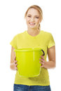 Young woman holding green bucket. Royalty Free Stock Photo