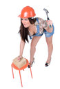Young woman holding hammer and nail Royalty Free Stock Photo