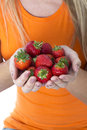 Young woman holding a handful of strawberries model released attractive Stock Image