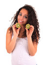 Young woman holding kiwi. Isolated over white. Isolated over whi Stock Photos