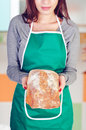 Young woman holding levain bread Royalty Free Stock Photo