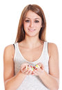 Young woman holding lots of pharmaceuticals all on white background Stock Photo