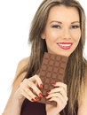Young Woman Holding a Milk Chocolate Bar Royalty Free Stock Photo