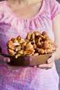 Young woman holding mushrooms in a pot Royalty Free Stock Photos