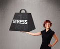 Young woman holding one ton of stress weight Royalty Free Stock Images