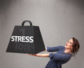 Young woman holding one ton of stress weight attractive Stock Photo