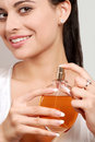 Young woman holding perfume bottle Stock Image