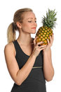 Young Woman Holding Pineapple Royalty Free Stock Photos
