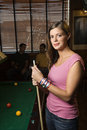 Young woman holding pool stick. Stock Images