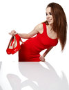 Young woman holding a red shoe Royalty Free Stock Photos