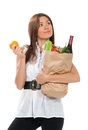Young woman holding shopping bag with groceries vegetables and fruits isolated on white background healthy eating concept Royalty Free Stock Photography
