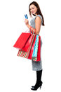 Young woman holding shopping bags and credit card fashionable posing with Stock Photos