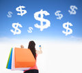 Young woman holding shopping bags and credit card with money cloud Royalty Free Stock Photo